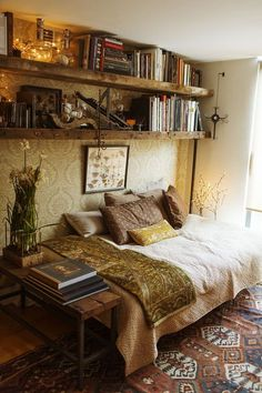 The floating book shelves add depth and texture to the room.  This looks so cozy and inviting!