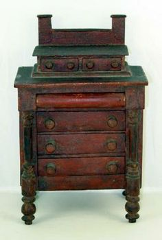 """Miniature Painted Chest of Drawers.  Circa 1840 to 1860. Massachusetts origin. Pine wood. Exceptional original red painted surface. Incredible detail. All hand made. Measures only 8"""" high by 5"""" wide by 3 1/2"""" deep. In excellent condition."""