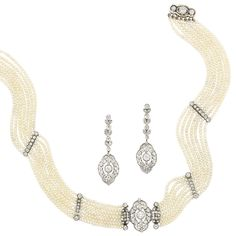 Belle Epoque Multistrand Seed Pearl, Platinum and Diamond Choker Necklace and Pair of Platinum and Diamond Pendant-Earrings. The necklace composed of seven strands of pearls centering a fancy-shaped openwork panel centering one old-mine cut diamond, flanked by a diamond-set floral motif and four diamond-set spacers, completed by a diamond-set clasp, totaling 61 old-mine and single-cut diamonds, the earrings of similar design, set throughout with 46 old-mine and single-cut diamonds,  circa 1905.