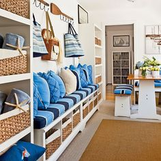 This is pretty much exactly what I want for our dining room/mudroom combo--I'd go smaller on the storage bench and bigger on the table, but this is the overall concept I've had in mind! Probably would go less beachy than this, though I do like the idea since we're only 15 minutes from the ocean!