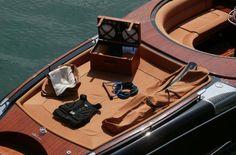 Maggi & Maggi >sleek wooden boat plus a picnic