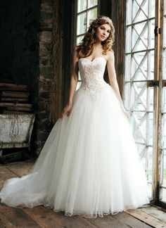 Sincerity wedding dress style 3656 Strapless satin sweetheart with 2 inch satin bias band with beaded lace, beaded lace bodice with Basque waist with full tulle skirt with scattered beading on skirt. This dress has a lace up back.