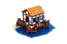 Here are some nice LEGO versions of essential medieval buildings from Age of Empires II by a group of LEGO enthusiasts. An Archery Range by Mark of Falworth and Barracks by Andrew JN above, and a few more below. Age Of Empires, Legos, Lego Bridge, Lego Beach, Lego Age, Lego Castle, Lego Worlds, Building Exterior, Lego House