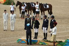 Silver medalist's Julia Krajewski, Sandra Auffarth, Ingrid Klimke and Michael Jung of Germany pose during the medal ceremony for the eventing team jumping final on Day 4 of the Rio 2016 Olympic Games at the Olympic Equestrian Centre on August 9, 2016 in Rio de Janeiro, Brazil.