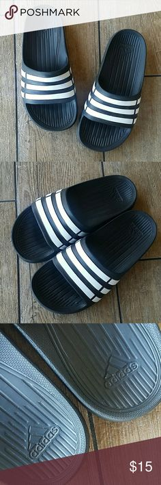 NWOT ADIDAS YOUTH SLIDES Black with white stripes Not adjustable Worn in house only to try on No rips or defects Smoke free home adidas Shoes Sandals & Flip Flops
