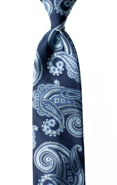 Agua Blue is part of the Seta di Gioia #paisley #necktie collection and showcases light #blue paisley patterns #woven into a smooth dark blue #satin background. Each Seta di Gioia #tie is #handmade in limited quantities using 100% #silk from Como, #Italy and bears our signature white saddle #stitch.  Visit Seta di Gioia at www.LuxuryItalianNeckties.com. #MensFashion #MensStyle #ties #neckties #Menswear
