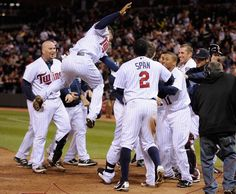 The Minnesota Twins celebrate a three run home run by Josh Willingham #16 to walk off in the ninth inning against the Oakland Athletics on May 29, 2012 at Target Field in Minneapolis, Minnesota. The Twins defeated the Athletics 3-4 in a walk-off.