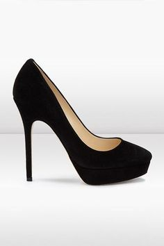 Basic Training: The Perfect Black Pumps #refinery29  http://www.refinery29.com/32664#slide6  The Platform Pump — If we're not walking the red carpet, there's not need for a 3-inch rise in the platforms of our pumps. This Jimmy Choo shoe is just tall enough for the platform lover, but it won't require a cane to operate.    Jimmy Choo Cosmic Pump, $695, available at Jimmy Choo. #promheelsred #jimmychooheelsred
