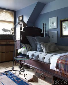 collective effort . the 1840s bed in a guest room was found at an estate sale and is dressed with a 19th-century matelasse coverlet and an amish horse blanket; the floor lamp and side table are vintage, and the walls are painted in benjamin moore's oxford gray and silver lining.
