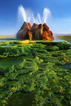 Located on a gated parcel of private property within the million-acre Black Rock Desert in Nevada, Fly Geyser is not a natural phenomenon. It was created accidentally in 1964 from a geothermal test well inadequately capped. The scalding water has erupted from the well since then, leaving calcium carbonate deposits growing at the rate of several inches per year. The brilliant red and green coloring on the mounds is from thermophillic algae thriving in the extreme micro-climate of the geysers.