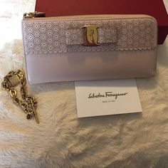 Salvatore Ferragamo SF wallet beautiful with any outfit. Light pink color, no edges damage or rub. One little hairline scratch tiny in the front not noticeable. ( it's hard to take a picture of the hairline) price is firm no !!!! Trades!!!! Condition 9/10 Salvatore Ferragamo Bags Wallets