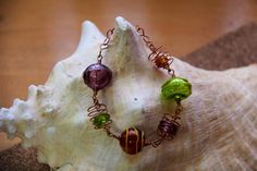 Wire wrapped lampwork bead bracelet - Baubles on Bangle.  Handmade by Jessica $35.00