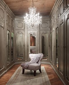 Luxurious master closet dressing room- love the chandelier