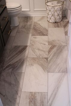 Sovereign Stone Pearl Porcelain tiles in 12×24 at Lowes.