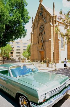 "Lowriding Heaven-I captured this picture in Santa Fe, NM. A 1963 Impala cruises past the church with the ""miraculous"" staircase that was supposedly built by an angel."