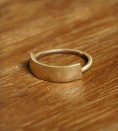 Brass Banner Ring | This simple brass ring features a thin banner of metal over an... | Rings