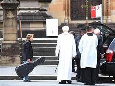 Angus Young was among mourners who remembered his brother Malcolm as a giant of Australian music.