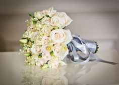 cream rose, lisianthus and lily of the valley wedding bouquet