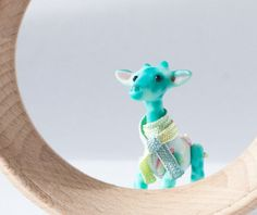 Tiny turquoise giraffe in a matchbox, 6 cm