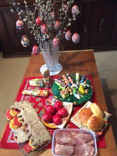 Our Easter table in 2017, with carrot an Nutella biscuits, cumin-and-garlic ham, buns, traditional red eggs and, of course, chocolate bunnies.