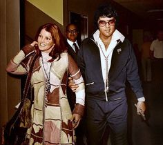 Elvis and Priscilla leave the courthouse in santa monica ca  there divorce was finalized..... they still remained best ov friends until the end..... :(