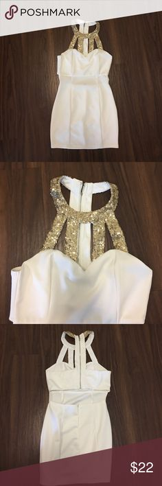 White mini cutout dress with gold embellishments White mini flattering dress. Embellishments on chest and cutout on the lower to mid-back. NEVER WORN! Tobi Dresses Mini