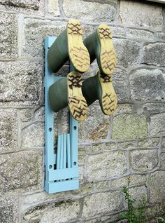 Rubber boot rack in use for two pairs of boots. I NEED this! I would like mine made out of old barn boards.