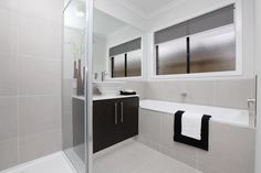 The luxurious Rochester has an abundance of rooms for family fun and entertaining. Visit: www.mimosahomes.com.au Call: 1300 MIMOSA Cupboard Storage, Home And Family, Modern Family, Double Vanity, Double Garage, Theater Room, Built In Wardrobe, Game Room, Room