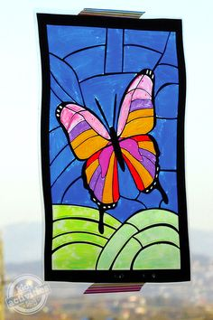 Kids can make this beautiful stained glass butterfly art they will love!