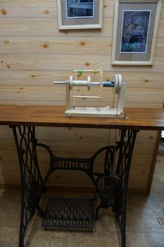 handmade spinning wheel on the pedal sewing machine