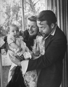 Rita Hayworth and Orson Welles hold newborn daughter Rebecca Welles at home in Hollywood, California, in December 1944. She is the only child of their five-year marriage.