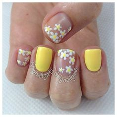 yellow polish patterned with yellow flowers #nails #nailart #nailpolish