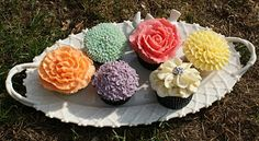 Flower Cupcakes - piped buttercream onto each cake to create roses, chrysanthenums, hydrangeas and fantasy flower patterns.