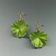 Celebrate all things green--and immortally stylish. These lime #anodized #aluminum #earrings do just that courtesy of a dangling lily pad. Meticulously handmade with a mesmerizing mix of texture and light that captures the season's most-wanted look in jewelry. #handmadejewelry $40