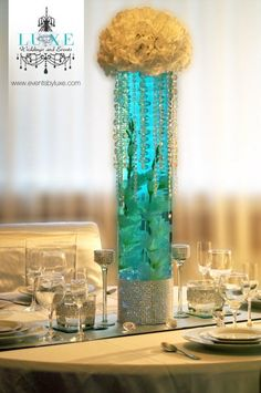 Aqua blue tall centerpiece with flowers and crystals by LUXE Weddings and Events London, Ontario