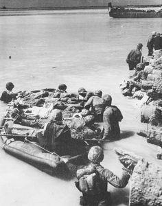 Casualties evacuated by rubber boat, Betio, Tarawa Atoll, 21 Nov 1943 (US Marine Corps photo)