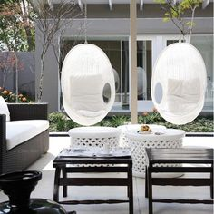 love the hanging chairs and the symetrical modern arrangment patio