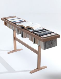 Booken is at the same time a table, a shelf and a library designed by Raw Edges for Imm Cologne 2013