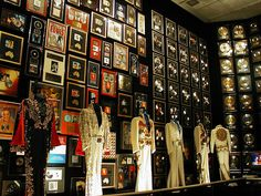 Graceland Estate in Memphis, Tennessee this was his racquet ballroom room now holds his jumpsuits and his gold records and his trophies