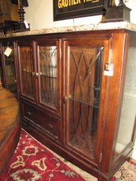 Price: $895.95  Item #: 122983 Glass front buffet with marble top. Measures 62 x 18 x 44.