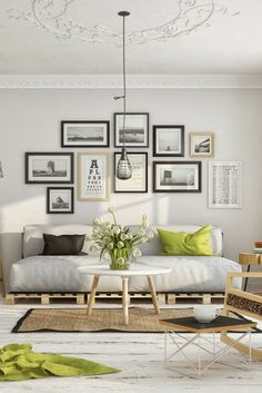 love the green accents in this room as well as the ceiling design and the picture frames all clustered