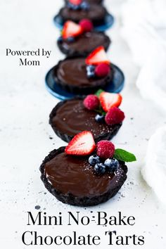 Chocolate lovers rejoice, these no-bake mini chocolate tarts will satisfy any chocolate craving. They're decadent, rich but not overly sweet and did we mention no-bake? Top with your favourite fruits or maybe toasted coconut and it's pure heaven! #chocolate #recipes #tarts #dessert #chocolatedesserts #chocolatetarts #NoBake #desserts #holidaydesserts #easydesserts #nobakedesserts #EasterDesserts #Easter #Valentines