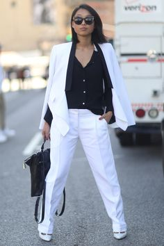 NYFW Street Style Day 7: Margaret Zhang outfitted a sleek black and white look.