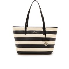 A striped Kate Spade New York tote rendered in textured faux leather. Open top line and leather handles. The interior has a zip pocket, 3 patch pockets, and a …