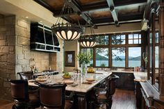 What a beautiful kitchen; amazing view, too.