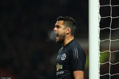 Sergio Romero screams to his team-mates as Derby threaten his goal during their FA Cup tie on Friday evening