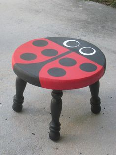 Hand painted wooden ladybug stool. I have this stool and it's fantastic! The seller also paints many other animals! Totally satisfied :)
