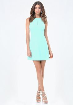 Sidewalk-café A-line dress with a cutout back and waist. Back tie keeps it sweet. Front bodice slit opening. Back neck button-loop closures. Back tie closure. Hidden back hook-and-eye and zip closure. Fully lined.