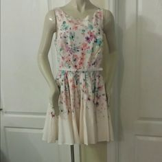 LC Lauren Conrad Dress Super cute. Gives you a unique look and feel. Zips in the back.  Belt is included. It's a size 12. Fits like a size 10. Dresses