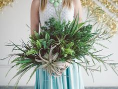 Fern and airplant bouquet by Enchahted Garden Floral Design.  Photo by Stephanie Collins Photography